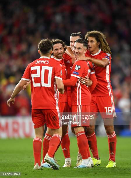 The Wales side celebrate their sides first goal, an own goal scored by Pavlo Pashayev of Azerbaijan during the UEFA Euro 2020 qualifier between Wales...