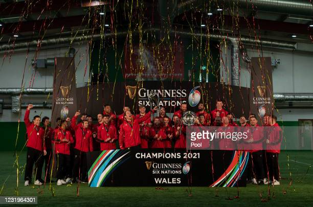 The Wales squad celebrate winning the 2021 Six Nations Championship with the Six Nations Trophy and the Triple Crown on March 27, 2021 in Cardiff,...