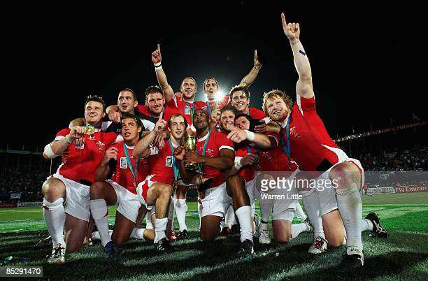 The Wales team celebrate on the pitch with the Melrose Cup after winning the Final against Argentina at the IRB Rugby World Cup Sevens 2009 at The...