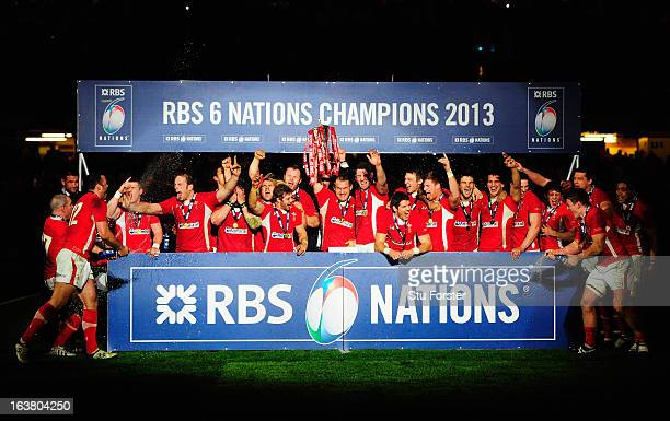 The Wales team celebrate winning the Championship after the RBS Six Nations match between Wales and England at Millennium Stadium on March 16 2013 in...