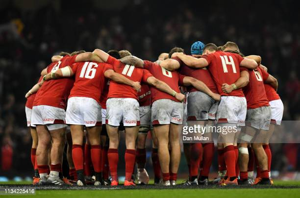 The Wales team huddle after the final whistle during the Guiness Six Nations match between Wales and England at the Principality Stadium on February...