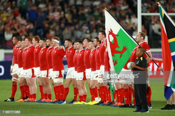 The Wales team line up as they sing their national anthem prior to the Rugby World Cup 2019 SemiFinal match between Wales and South Africa at...