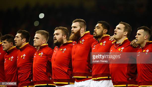 The Wales team sing the national anthem prior to kickoff during the RBS Six Nations match between Wales and France at the Principality Stadium on...