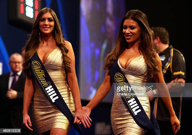 The walk on girls are seen during the William Hill PDC World Darts Championships on Day Ten at Alexandra Palace on December 30 2014 in London England