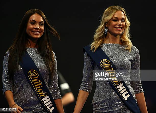 The walk on girls during the 2016 William Hill PDC World Darts Championships on Day Four at Alexandra Palace on December 20 2015 in London England