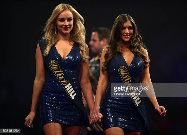 The walk on girls exit the stage during the semifinal match between Adrian Lewis of England and Raymond van Barneveld of Holland during the 2016...