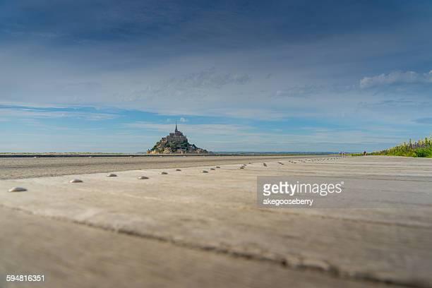 the walk way to mont saint michel in france - モンサンミッシェル ストックフォトと画像
