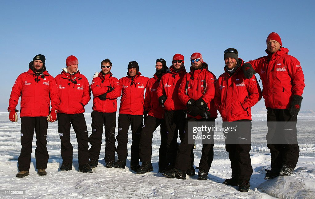 The Walk with the Wounded team Henry Cookson, Britain's Prince Harry, Guy Disney, Simon Daglish, Edward Parker, Jaco Van Gass, Martin Hewitt, Steven Young and team leader Inge Solheim pose for photographs during training on the island of Spitsbergen, situated between the Norwegian mainland and the North Pole, on March 30, 2011 for their last days of packing before setting off to walk to the North Pole. The team's expedition will last four weeks and see them cover up to 200 miles (320 kilometres) of the frozen Arctic Ocean on foot, pulling their own equipment in temperatures as low as minus 60 degrees Centigrade. AFP PHOTO/David Cheskin/WPA