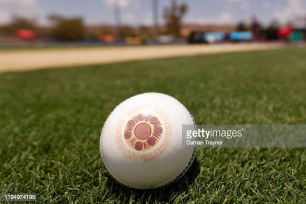 The 'Walkabout Wickets' art work by Aunty Fiona Clarke is seen on the match ball before the Big Bash League match between the Hobart Hurricanes and...