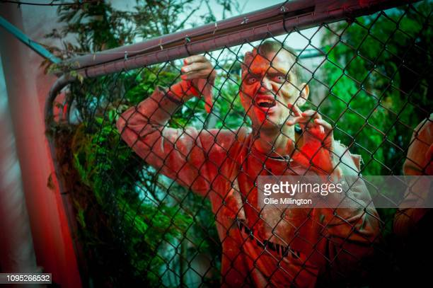 The Walking Dead Zombie actor in character seen in an immersive display recreating a scene from the Terminus story arc of seasons 6 and 7 during The...