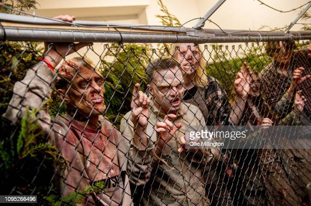 The Walking Dead Zombie actors in character seen in an immersive display recreating a scene from the Terminus story arc of seasons 6 and 7 during The...