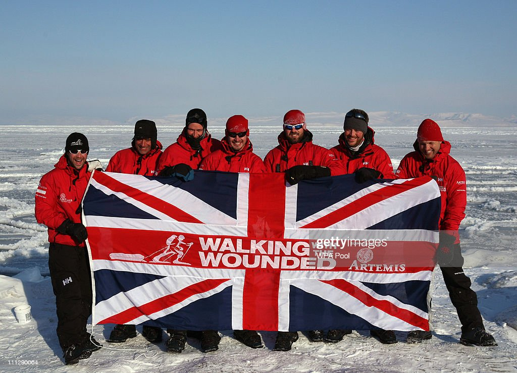 The Walking with the Wounded team trekking to the North Pole (L-R) Guy Disney, Simon Daglish, Edward Parker, Jaco Van Gass, Martin Hewitt, Steven Young and team leader Inge Solheim pose for a team photo as they train on the Norwegian Island of Spitsbergen on March 31, 2011 in Spitsbergen, Norway. Harry is training before joining the group of wounded servicemen, for the first five days, trekking to the North Pole to raise money for the charity Walking With The Wounded of which he is patron. Temperatures dropped as low as 25C last night in the camp in a valley near Longyearbyen as the team acclimatised to the extreme conditions, eating an evening meal out of freeze-dried packets and melting ice to drink and cook with.