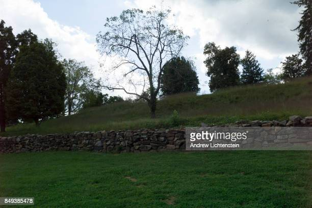 The wall at the famous Sunken Road one of the bloodiest spots in American history catches the last light at the Civil War battlefield on September 15...