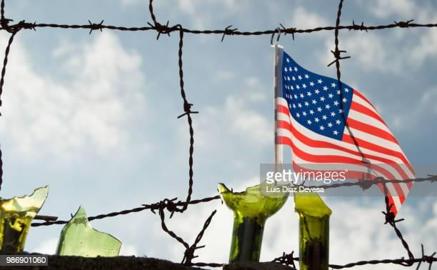 the wall border separating united states - emigration and immigration stock pictures, royalty-free photos & images