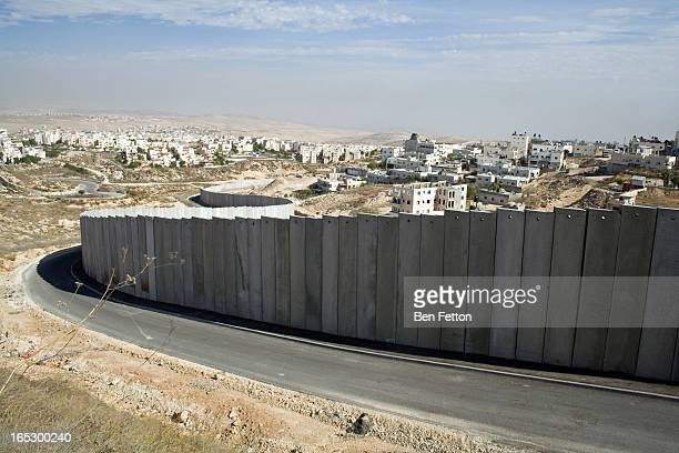 CONTENT] The wall encircling the Shaufat Refugee Camp in East Jerusalem isolating the community from Jerusalem and much of its own land