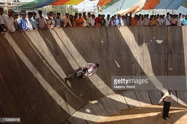 The Wall of Death' is a dare devil motor bike show where the biker takes life risk running his bike along the wall of a large wooden well This type...