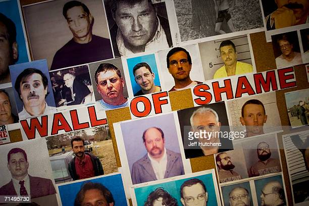 The Wall of Shame in the Exploited Child Unit of the National Center for Missing and Exploited Children is a wall of photos depicting people arrested...