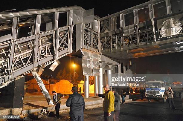 The wall of the stairs are blown off at a bus terminal, 7 kilometres west of Damascus city centre on November 26, 2013 in Damascus, Syria. Official...