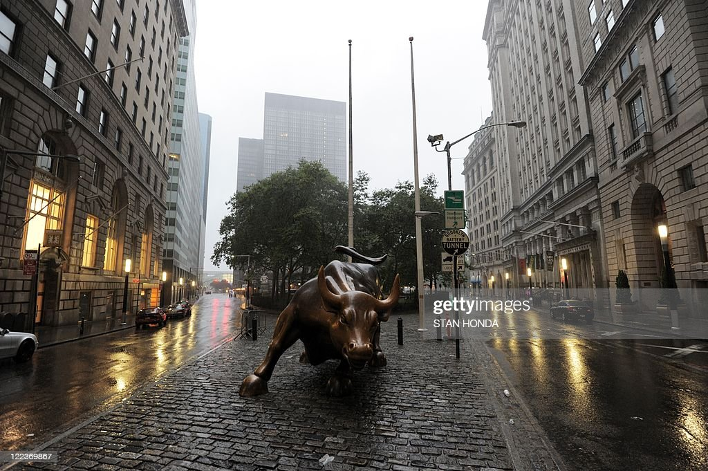 The Wall Street bronze Bull sits between empty streets in ...