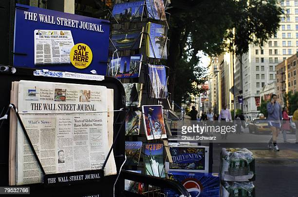 The wall Street Journal news paper stands for sale in a newsstand on June 6 2007 in the Union Square neighborhood of New York City