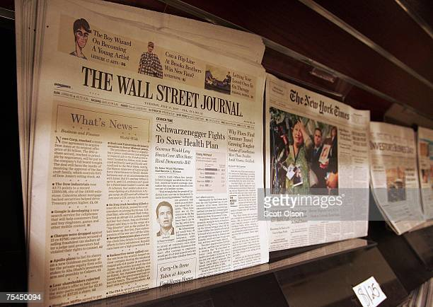The Wall Street Journal newspaper is offered for sale along side other papers at a newsstand in the Chicago Board of Trade building July 17 2007 in...