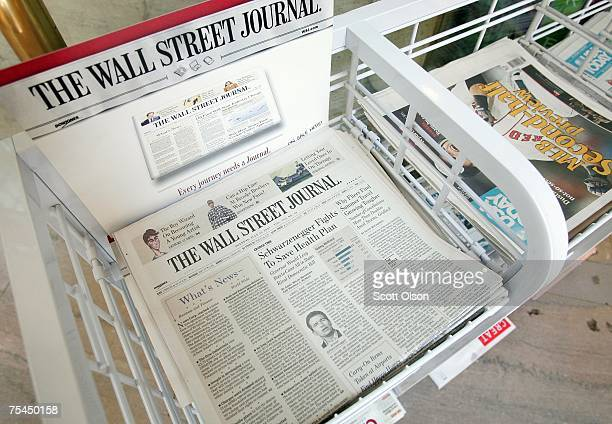 The Wall Street Journal newspaper is offered for sale alongside other papers at a newsstand in the Chicago Board of Trade building July 17 2007 in...