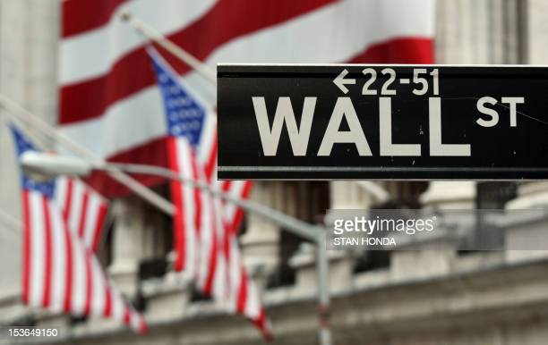 The Wall Street sign near the front of the New York Stock Exchange August 5 2011 AFP PHOTO/Stan HONDA
