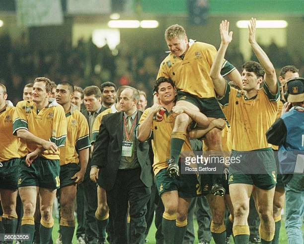 The Wallabies complete a lap of hounour after they defeated France in the final of the Rugby World Cup3512 at the Millennium Stadium Cardiff Saturday