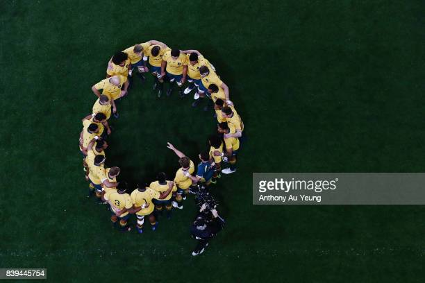 The Wallabies form a team huddle prior to The Rugby Championship Bledisloe Cup match between the New Zealand All Blacks and the Australia Wallabies...