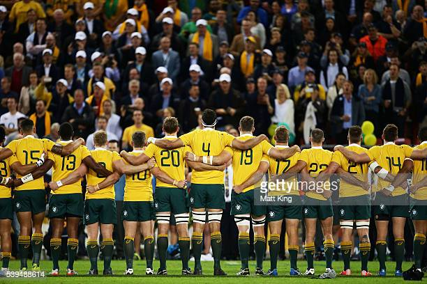 The Wallabies line up for the Australian national anthem during the International Test match between the Australian Wallabies and England at Suncorp...