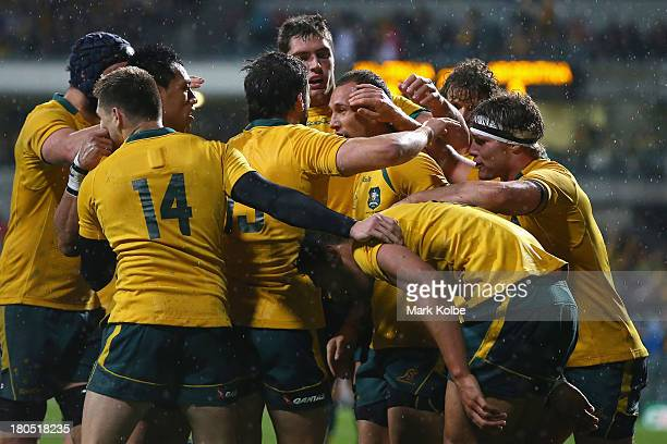 The Wallabies players celebrate after Israel Folau of the Wallabies scored a try during The Rugby Championship match between the Australian Wallabies...