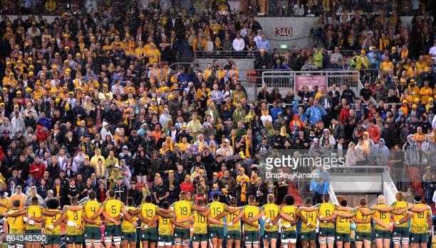 The Wallabies players embrace before the Bledisloe Cup match between the Australian Wallabies and the New Zealand All Blacks at Suncorp Stadium on...