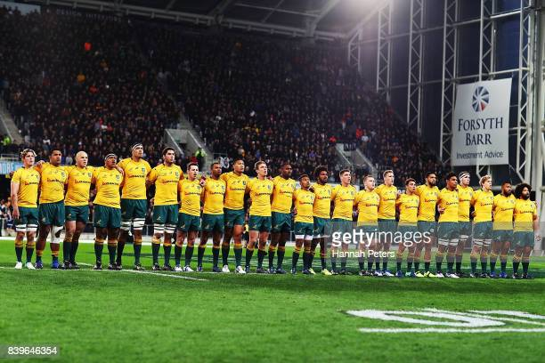 The Wallabies sing the national anthem ahead of The Rugby Championship Bledisloe Cup match between the New Zealand All Blacks and the Australia...