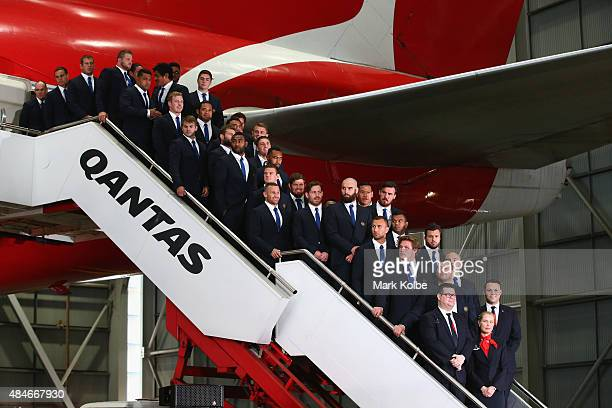 The Wallabies World Cup Squad pose on the steps of a plane during the Australian Wallabies Rugby World Cup squad announcement at Hangar 96 Qantas...