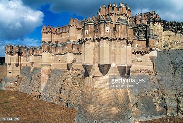 The walls and moat of Coca castle Castile and Leon Spain 15th century