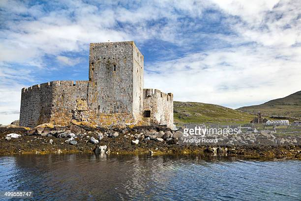 CONTENT] The walls and tower of medieval Kisimul Castle seen from the bay Kisumul sits on a rocky islet at Castlebay just off the coast of Barra...