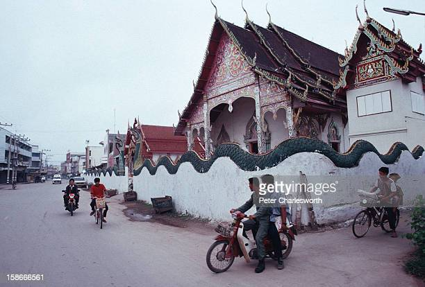 The walls around a temple in Nan are decorated with long Nagas or snakes