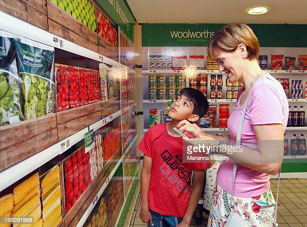 The walls of Sydney's Town Hall Station are bedecked to resemble a Woolworths' supermarket shelf in Australia's first virtual supermarket at Town...