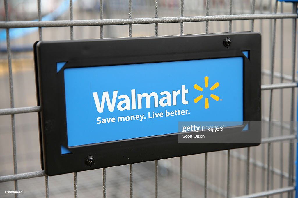 The Walmart logo is displayed on a shopping cart at a Walmart store on August 15, 2013 in Chicago, Illinois. Walmart, the world's largest retailer, reported a surprise decline in second-quarter same-store sales today. The retailer also cut its revenue and profit forecasts for the fiscal year.