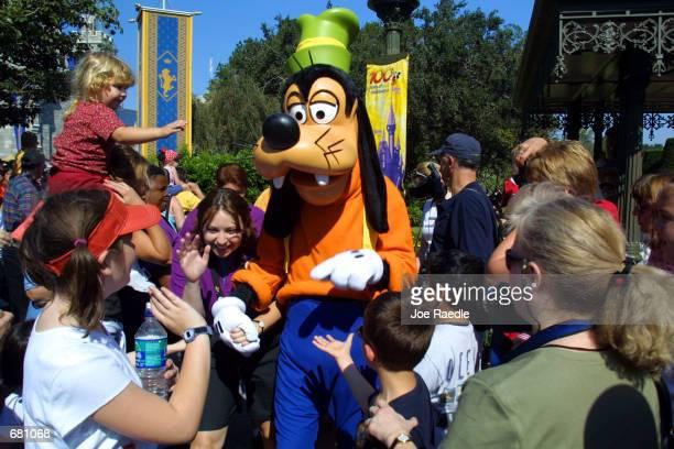The Walt Disney character Goofy makes his way through a crowd at Disney's Magic Kingdom November 11 2001 in Orlando Florida