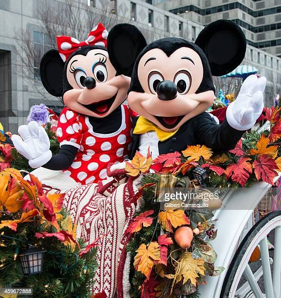The Walt Disney Characters Minnie and Mickey Mouse attend the 95th Annual 6abc Dunkin' Donuts Thanksgiving Day Parade on November 27 2014 in...