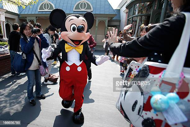The Walt Disney Co character Mickey Mouse greets visitors at Tokyo Disneyland operated by Oriental Land Co in Urayasu City Chiba Prefecture Japan on...