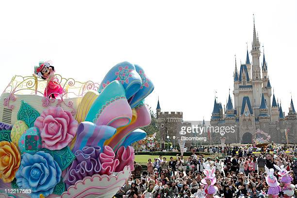 The Walt Disney Co character Minnie Mouse performs during a parade at Tokyo Disneyland operated by Oriental Land Co in Urayasu city Chiba prefecture...