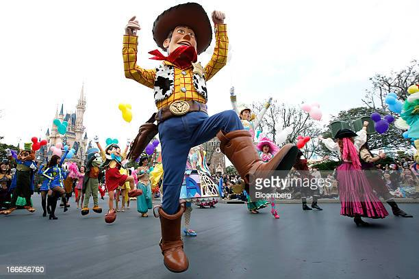 The Walt Disney Co character Woody center performs during a ceremony to mark the 30th anniversary of Tokyo Disneyland operated by Oriental Land Co at...