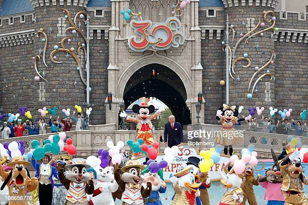 The Walt Disney Co characters Mickey Mouse center left and Minnie Mouse center right perform with other characters as Toshio Kagami chairman and...