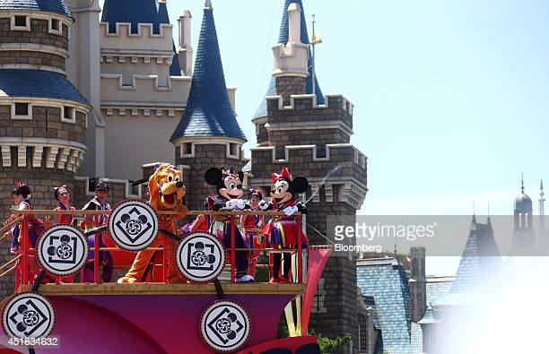 The Walt Disney Co characters Mickey Mouse front center and Minnie Mouse right perform in front of the Cinderella Castle during an event named...