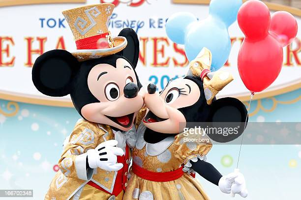 The Walt Disney Co characters Mickey Mouse left and Minnie Mouse perform during a ceremony to mark the 30th anniversary of Tokyo Disneyland operated...