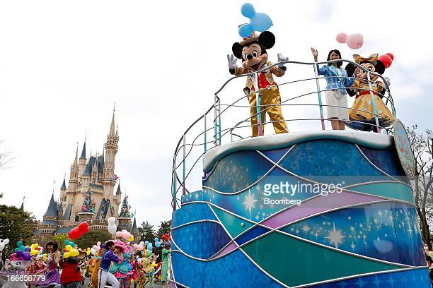 The Walt Disney Co characters Mickey Mouse left and Minnie Mouse right perform on top of a stand during a ceremony to mark the 30th anniversary of...