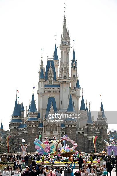 The Walt Disney Co characters Mickey Mouse right and Minnie Mouse perform during a parade at Tokyo Disneyland operated by Oriental Land Co in Urayasu...