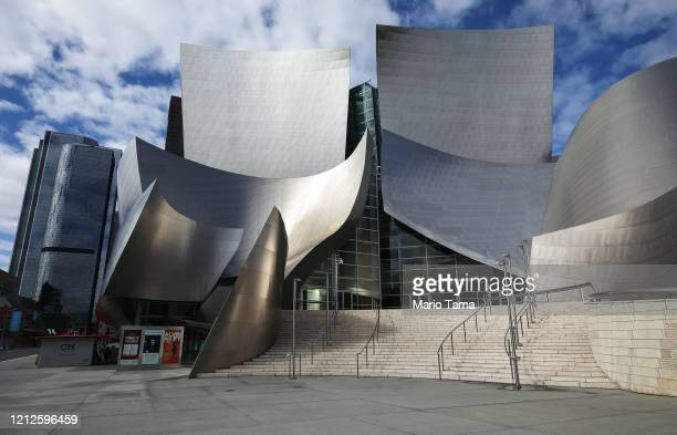 The Walt Disney Concert Hall, designed by Frank Gehry, stands shuttered on March 15, 2020 in Los Angeles, California. Many movie theaters and other...